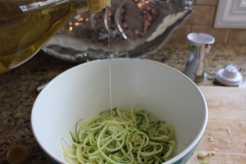 Dress your zucchini noodles with olive oil, salt, & pepper.